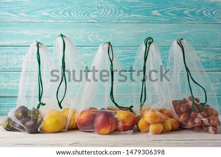 Fruits n reusable eco bags at blue wooden background. Recycled bags instead of plastic bags. Plastic free. Foto stock ©