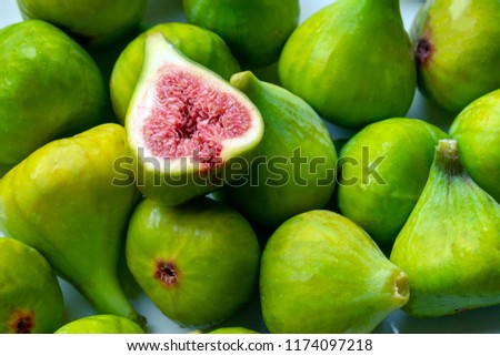 Fruits of fig tree with leaves on white background/ Fresh figs with leaves on rustic wooden table/ Healthy lifestyle concept / Healthy food concept  Stock foto ©
