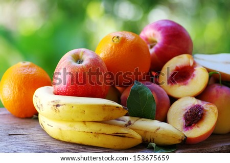 fruits on table, green background