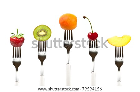 fruits on the collection of forks, diet and healthy eating concept