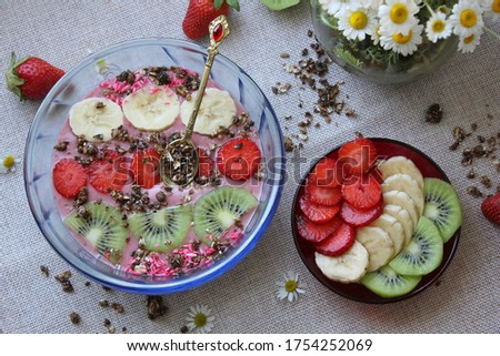 Fruits smoothie with granola, banana, kiwi and strawberries Сток-фото ©