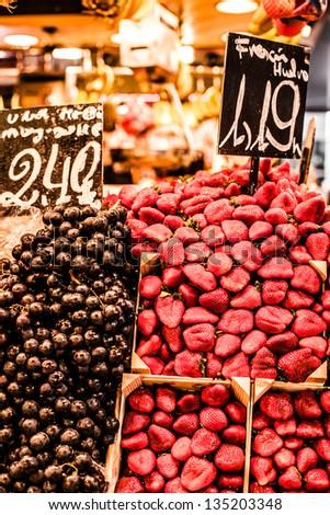 Fruits stand in La Boqueria market, Barcelona Spain