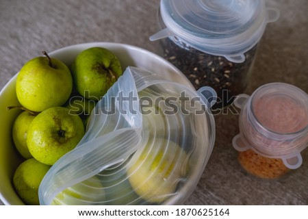 Photo of  Fruits, vegetables and grains packed with environmentally safe round silicone stretch lids ready for storage. Reusable eco-friendly kitchen products. Zero waste and sustainable plastic free lifestyle