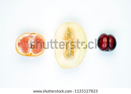 Fruits, vegetables symbol of different female vaginas. Sex concept. Melon, plum, grapefruit
