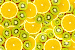 Fruity background set of slices of orange fruit and kiwi. Many slices of kiwi fruit and orange fruit, Fresh kiwis and orange fruit, interesting fruit composition