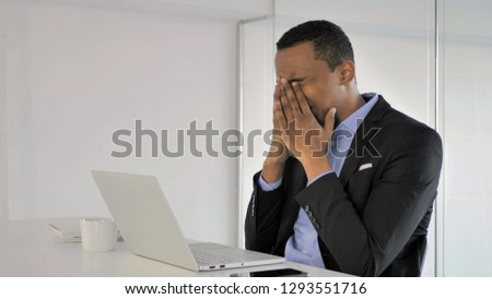Frustrated Angry African Businessman Working on Laptop
