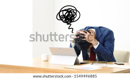 Frustrated asian businessman in office.