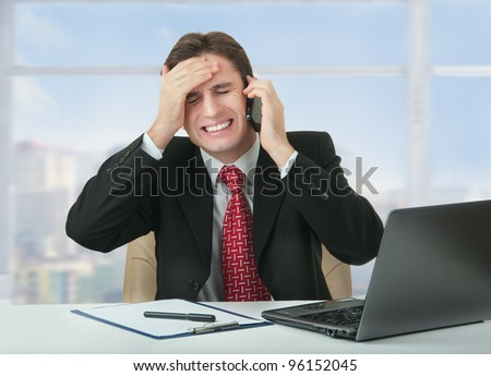 frustrated business man talking on the phone,  businessman lost, is under stress