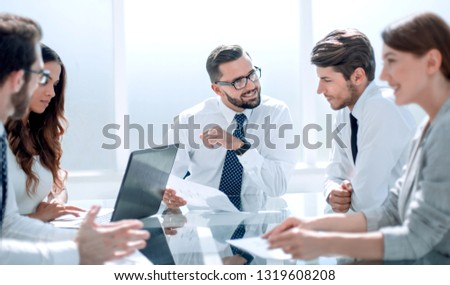 Frustrated business people sitting at the table in office