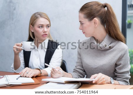 Frustrated business people sitting at the table in office, arguing while discussing project. Setup studio shooting. - Shutterstock ID 754011964