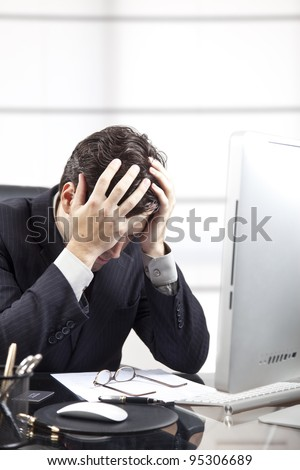 frustrated businessman in front of the computer.