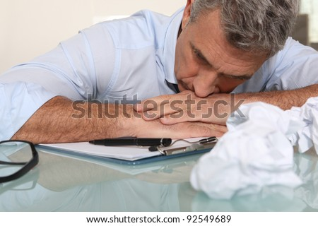Frustrated businessman in need of inspiration