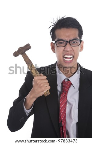 Frustrated businessman ready to hit his head with hammer on white background