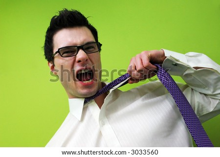 Frustrated businessman screams and pulls at his tie