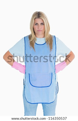 Frustrated cleaning woman on white background