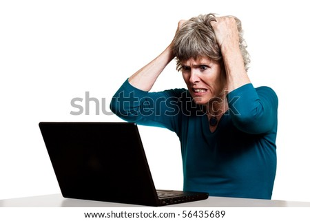 Frustrated computer user tearing out her hair