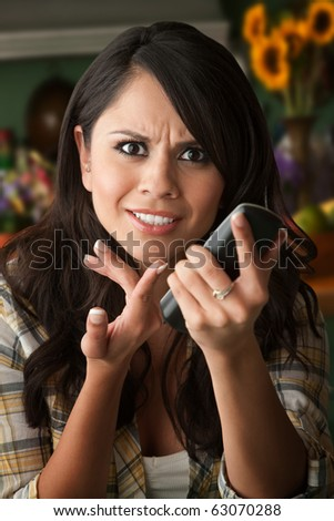 Frustrated Latina Woman on Phone  Waiting for Service or taking Sales call