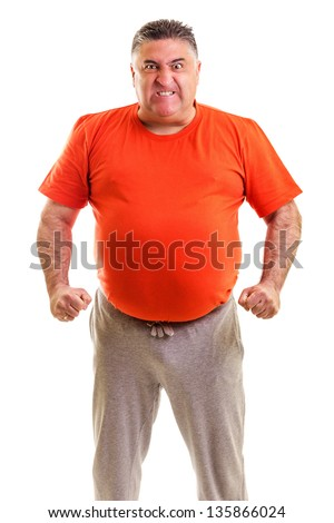 Frustrated man clenching his fist against white background