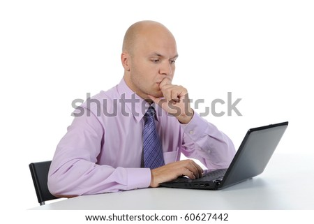 Frustrated man in front of laptop. Isolated on white background