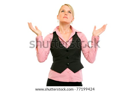 Frustrated modern business woman looking up and  raising her hands isolated on white