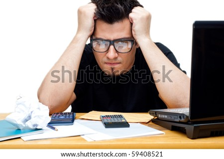 frustrated nerdy accountant at his desk isolated