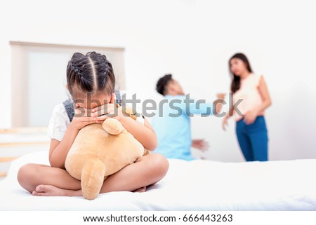 Frustrated of little girl is disaster in argument of mother and father in family conflict,Family concept. #666443263