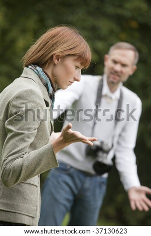frustrated photographer and unhappy model shooting outdoor