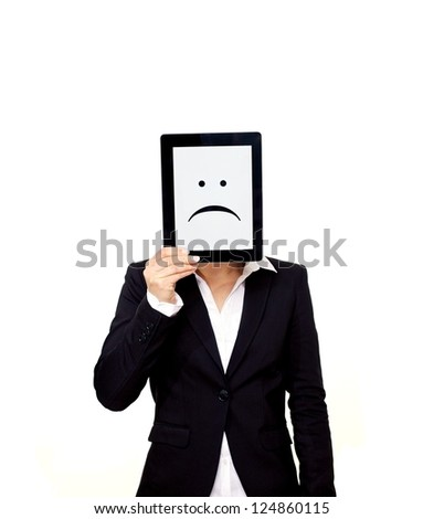 Frustrated professional holding up a digital tablet with a sad emoticon on screen