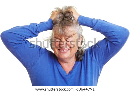 Frustrated retired woman pulling her gray hair