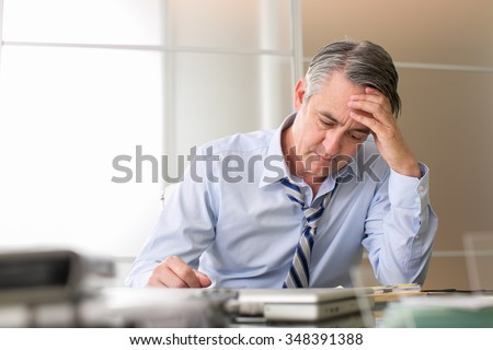 Frustrated stressed business man in an office
