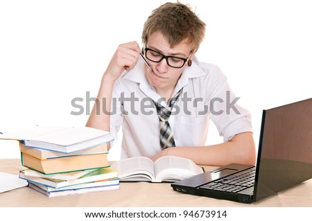 frustrated student sits behind a desk isolated on white background