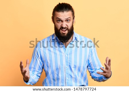 frustrated stylish man with open mouth expressing negative emotion. frustration concept. isolated yellow background