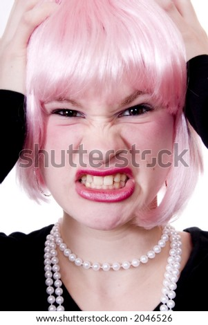 Frustrated teen wearing a pink wig and a string of pearls.