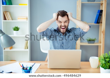 Frustrated  tired man  with laptop having a lot of work and screaming #496484629