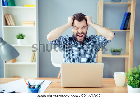 Frustrated  tired man  with laptop having a lot of work and screaming #521608621