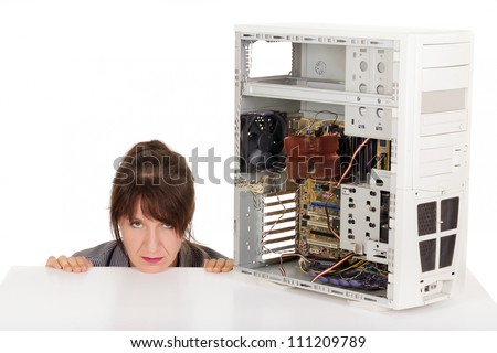frustrated woman and broken computer