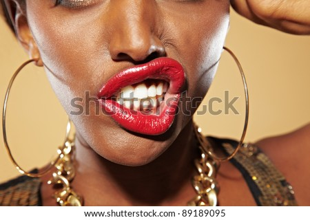 Frustrated young african woman bares her teeth