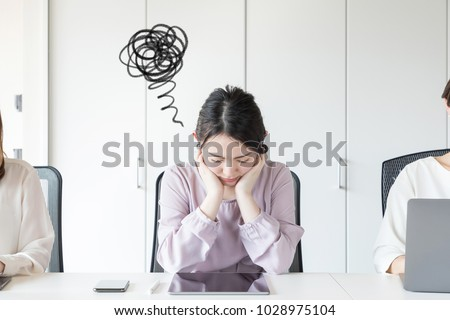 Frustrated young asian woman.