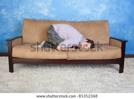 Frustrated young man on sofa