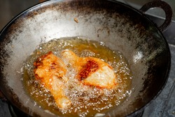 Fry the chicken in a pan with boiling oil