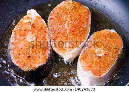 Frying fresh salmon on the pan