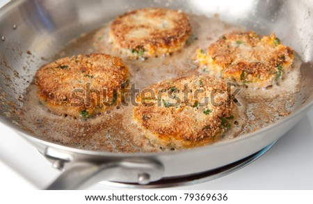 Frying Paleo Style Salmon and Sweet Potato Cakes with Fresh Parsley
