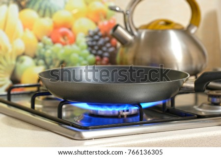 frying pan on a stove stock photo