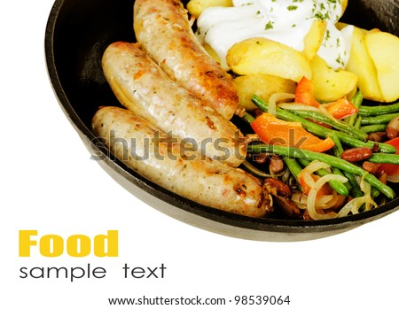 frying pan with a Bavarian sausage and vegetable ragout
