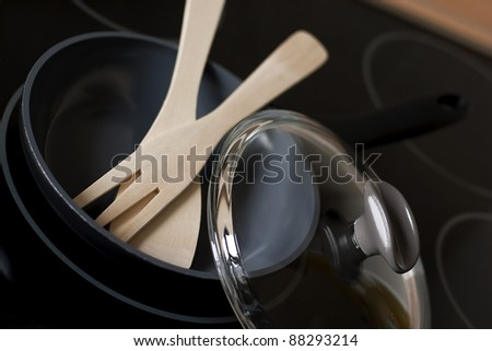 Frying pan with kitchen utensils on a stove