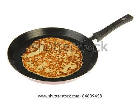 Frying pan with pancake isolated over white background