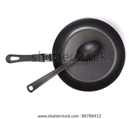 Frying pan with utensil. View from above. Isolated on white background