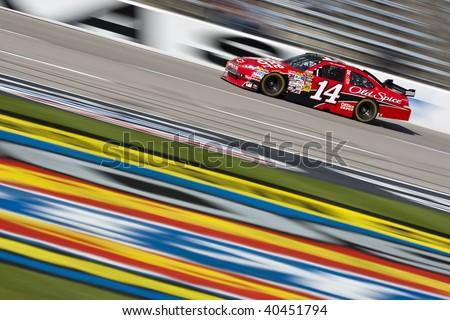 FT. WORTH, TX - NOV. 6:Tony Stewart brings his Office Depot Chevrolet through the frontstretch during a practice session for the Dickies 500 race in Ft. Worth, TX on Nov. 6, 2009.
