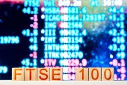 ftse 100 concept. wooden blocks with the inscription ftse 100