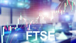 FTSE 100 Financial Times Stock Exchange Index United Kingdom UK England Investment Trading concept with chart and graphs.